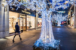 Night view of Multrees Walk upmarket shopping street with Christmas lights in off St Andrews Square in Edinburgh , Scotland, United Kingdom.