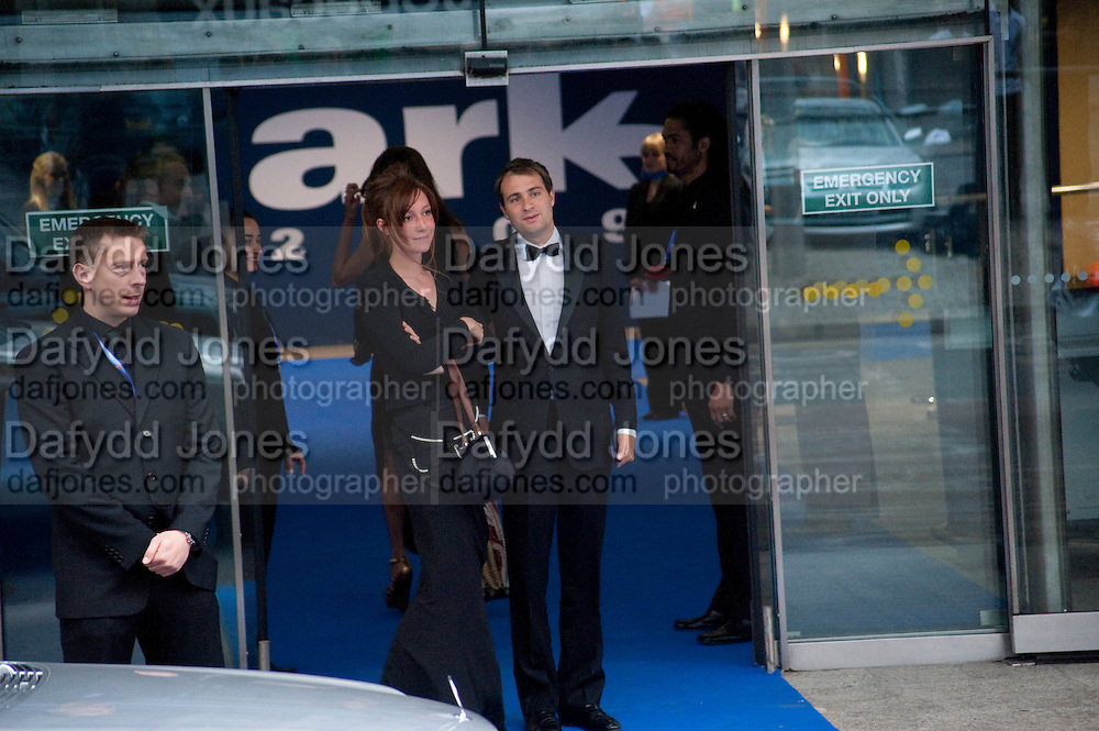 Kate Goldsmith; Ben Goldsmith, Ark fundraising dinner and auction. ( Absolute Return for Kids ) Old Eurostar Terminal. Waterloo Station. London. 4 June 2009