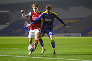 AFC Wimbledon attacker Shane McLoughlin (19) battles for possession  during the EFL Trophy match between AFC Wimbledon and U21 Arsenal at Plough Lane, London, United Kingdom on 8 December 2020.