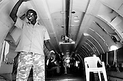 JAACH, SUDAN - JANUARY 11, 2008: A plane arrives carrying aid to Sudanese refugees. Located in the southern Darfur region, Jaach is home to many internally displaced Sudanese fleeing conflict.
