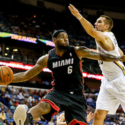Oct 23, 2013; New Orleans, LA, USA; Miami Heat small forward LeBron James (6) passes asNew Orleans Pelicans power forward Ryan Anderson (33) defends during the second half of a preseason game at New Orleans Arena. The Heat defeated the Pelicans 108-95. Mandatory Credit: Derick E. Hingle-USA TODAY Sports