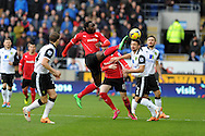 Cardiff city's Kenwyne Jones © stretches to control the ball . Barclays Premier league, Cardiff city v Norwich city match at the Cardiff city Stadium in Cardiff, South Wales on Saturday 1st Feb 2014.<br /> pic by Andrew Orchard, Andrew Orchard sports photography.