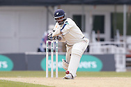 Yorkshire All-rounder Adil Rashid  with a drive during the Specsavers County Champ Div 1 match between Yorkshire County Cricket Club and Surrey County Cricket Club at Headingley Stadium, Headingley, United Kingdom on 10 May 2016. Photo by Simon Davies.