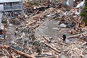 People search the rubble for personal effects after the tsunami in Ofunato, Iwate, Japan. March 17th 2011