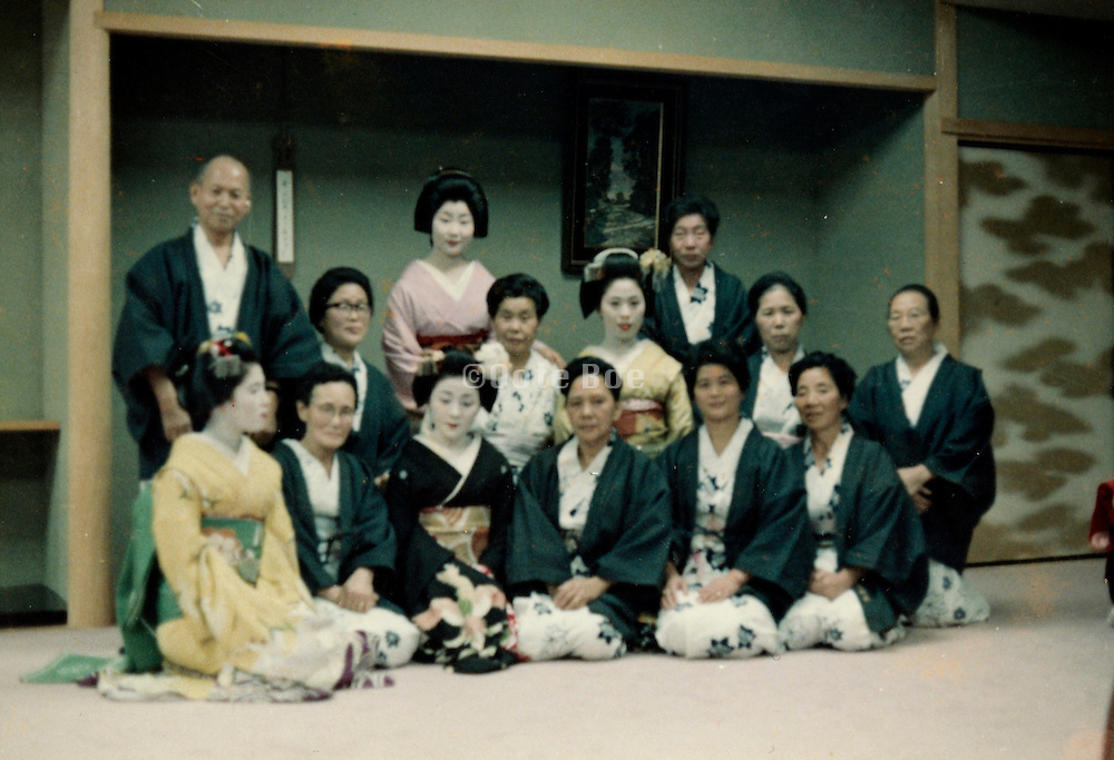 Maiko with their guests in an old style room Japan late 1980s