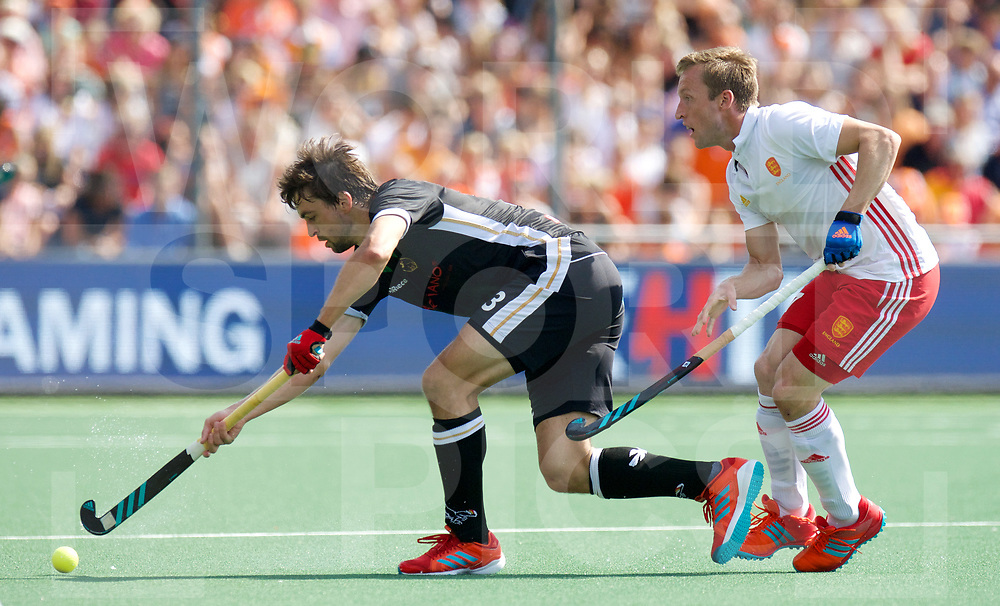 AMSTERDAM - Rabo EuroHockey Championships <br /> 19 Germany - England<br /> foto: Tobias Hauke and Barry Middleton.<br /> Worldsportpics COPYRIGHT FRANK UIJLENBROEK