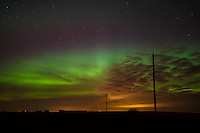 March 17, 2015 - The aurora was very strong but Calgary was almost completely socked in with cloud so we had to head much farther north than normal in order to find it. This image was taken from a side road a few kilometers east of Highway 2 near Olds, AB. The Northern Lights were very strong when we first arrived at this location but steadily faded after that.<br /> <br /> ©2015, Sean Phillips<br /> http://www.RiverwoodPhotography.com