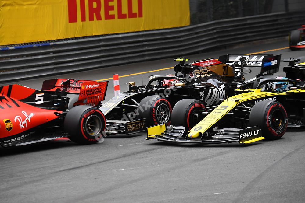 Sebastian Vettel (Ferrari), Kevin magnussen (Haas-Ferrari) and Daniel Ricciardo (Renault) in the first corner after the start of the 2019 Monaco Grand Prix. Photo: Grand Prix Photo