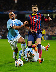 Barcelona Defender Gerard Pique (ESP) is tackled by Man City Defender Pablo Zabaleta (ARG) and Defender Vincent Kompany (BEL) - Photo mandatory by-line: Rogan Thomson/JMP - Tel: 07966 386802 - 18/02/2014 - SPORT - FOOTBALL - Etihad Stadium, Manchester - Manchester City v Barcelona - UEFA Champions League, Round of 16, First leg.