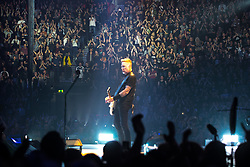 © Licensed to London News Pictures . 28/10/2017 . Manchester , UK . The audience watch James Hetfield in the foreground . Metallica perform at the Manchester Arena . Photo credit : Joel Goodman/LNP