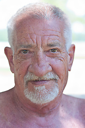 portrait of a mature man with many wrinkles on his face