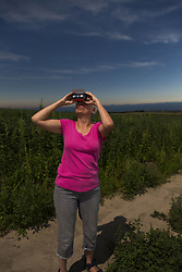 August 21, 2017 - Arnold, Nebraska, U.S. - Arnold, Nebraska - 21 August 2017 - Susan Newell, 68, watches the total eclipse of the sun, just before totality, from the Nebraska Sandhills..MR (Credit Image: © Jim West via ZUMA Wire)