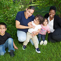 Supportive Housing program case worker, Melissa (in white shirt) with her client Irma and three of Irma's four children: Joels, age 5, Delicia, age 3 and Julio, age 18 months. Melissa has provided support to Irma for over two years. <br /> <br /> Irma, age 24, left home at the age of nine after she and her brother suffered abuse at the hands of their step father. After several years in the care of foster homes and living homeless, Irma became pregnant at age 15. By the age of 23, Irma had lived through periods of homelessness and had become mother to four children with two different men, both of whom were abusive. Six months into her fourth pregnancy, Irma's partner threw her down the stairs and she went into premature labour. Medical staff told Irma that she would miscarry but her youngest son, Julio survived after spending the first six months of his life in hospital. The sustained involvement of medical professionals in Irma's life alerted the Supportive Housing program to her situation. Case worker Melissa began working with Irma, offering support, advice and providing the funds to purchase items for the care of baby Julio. Melissa made representations to the Department of Children and Families (DCF) to vouch for Irma's character and convince them that Irma should not be separated from her children. Melissa encouraged Irma to go back to school and complete her high school diploma. <br /> <br /> Supportive Housing  provided Irma a housing-voucher so that she could keep her children and live independently of her abusive partner. Irma now lives with her children who have rooms of their own and a back yard in which to play. Julio, now eighteen months, has significant health needs but the relative stability of Irma's life now means she can look to the future with a sense of optimism. She hopes to complete her associates degree in nursing and eventually earn an income that will allow her to live in accommodation without the need of a subsidy from Supportive Housing.