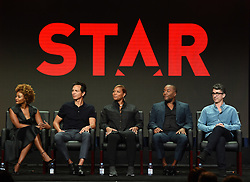 BEVERLY HILLS - AUGUST 8: Executive Producer Karin Gist, cast members Benjamin Bratt and Queen Latifah, Co-Creator/Co-Writer/Executive Producer Lee Daniels and Co-Creator/Co-Writer/Executive Producer Tom Donaghy onstage during the panel for 'STAR' at the FOX portion of the 2017 Summer TCA press tour at the Beverly Hilton on August 8, 2017 in Beverly Hills, California. (Photo by Frank Micelotta/Fox/PictureGroup) *** Please Use Credit from Credit Field ***