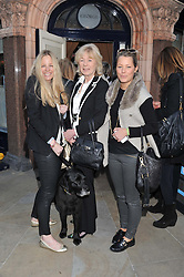 Left to right, ASTRID HARBORD, SARAH JULIET HARBORD and DAVINA HARBORD and Guinness the dog at The Dog's Trust Awards announcement held at George, 87-88 Mount Street, London on 27th March 2012.
