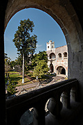 View of the courtyard gardens of the convent at the San Nicolas Tolentino Temple and Ex-Monastery in Actopan, Hidalgo, Mexico. The colonial church and convent  was built in 1546 and combine architectural elements from the romantic, gothic and renaissance periods.