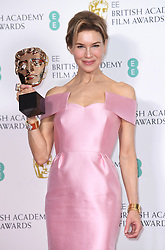 Renee Zellweger with her award for Best Actress at the 73rd British Academy Film Awards held at the Royal Albert Hall, London.. Photo credit should read: Doug Peters/EMPICS