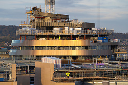 Edinburgh, Scotland, UK. 21 October 2020. Sunrise view of construction work at new St James Quarter property development in central Edinburgh. The new development has shopping, residential and hotel space. Pictured is the distinctive curved outline of the new W Edinburgh hotel being clad in copper coloured cladding. Iain Masterton/Alamy Live News