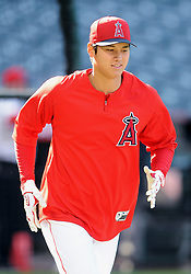 April 19, 2018 - Anaheim, CA, U.S. - ANAHEIM, CA - APRIL 19: Los Angeles Angels of Anaheim designated hitter Shohei Ohtani (17) runs to first base during batting practice before a game against the Boston Red Sox played on April 19, 2018 at Angel Stadium of Anaheim in Anaheim, CA. (Photo by John Cordes/Icon Sportswire) (Credit Image: © John Cordes/Icon SMI via ZUMA Press)