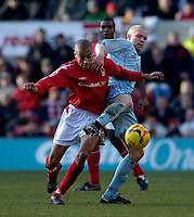 Photo: Jed Wee.<br />Nottingham Forest v Chesterfield. Coca Cola League 1.<br />31/12/2005.<br />Forest's James Perch (L) tries to get past Chesterfield's Derek Niven.