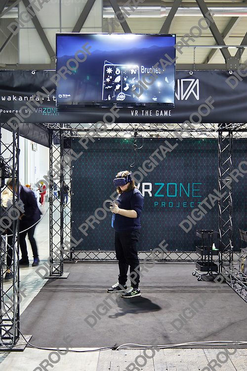 Milan, Italy - March 8 2019 Cartoomics Comic Con  A visitor tries Virtual Reality Technology
