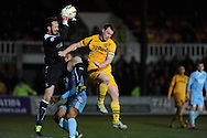 Plymouth Argyle goalkeeper Jake Coll claims the ball from Newport's Mike Flynn. Skybet football league two match, Newport county  v Plymouth Argyle at Rodney Parade in Newport, South Wales on Tuesday 8th April 2014.<br /> pic by Andrew Orchard, Andrew Orchard sports photography.