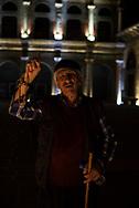 Late on a summer night at the historic Ulu Cami mosque in Diyarbakir, Turkey, a senior Kurdish man points skyward and recites a prayer.