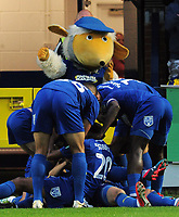Football - 2018 / 2019 EFL Carabao Cup (League) Cup - AFC Wimbledon vs. West Ham United<br /> <br /> Joe Pigott of Wimbledon celebrates his goal with team mates and the 'Wombles Mascot', at Cherry Red Records Stadium (Kingsmeadow).<br /> <br /> COLORSPORT/ANDREW COWIE