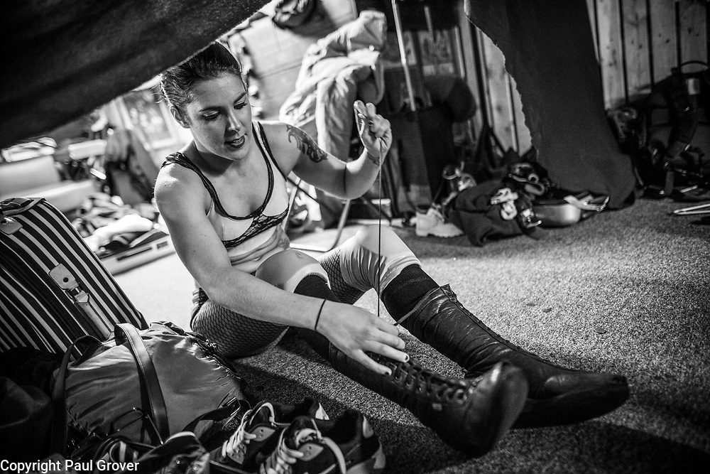 """Photo Dispatch. Pic Shows Women Wrestlers getting ready before performing at the EVE event at the Resistance Gallery in Bethnal Green.Pro-Wrestling: Eve was originally developed in 2010 by married couple Dann and Emily Read due to their desire to showcase women's professional wrestling.[1][2] They also wanted to provide positive female role models for their daughter.[1][3] Emily describes the promotion as a """"feminist, grassroots promotion,"""" as well as punk.[1] In 2012, Pro-Wrestling: EVE was included in Vice magazine's documentary The British Wrestler,[4] as well as a feature in Fabulous magazine.[5]<br /> In 2017, both women's wrestling and British professional wrestling in general enjoyed a growth in popularity internationally.[1] The promotion broadcasts shows on internet pay-per-view (iPPV).[6]<br /> <br /> The Pro-Wrestling: EVE Championship is a women's professional wrestlingchampionship. Championship reigns are determined by professional wrestling matches, in which competitors are involved in scripted rivalries. These narratives create feuds between the various competitors, which cast them as villains and heroines."""