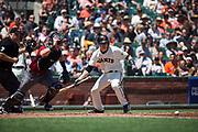 San Francisco Giants shortstop Kelby Tomlinson (37) bunts against the Arizona Diamondbacks at AT&T Park in San Francisco, California, on August 6, 2017. (Stan Olszewski/Special to S.F. Examiner)