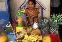 """making fruit drinks  in Luang Prabang, Laos, a UNESCO World Heritage Center..with the """"Tree of Life"""" painting on the front.."""