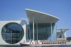 Modern parliament building cruise boat tourists