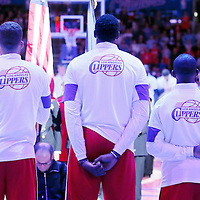 17 October 2014: Los Angeles Clippers forward Blake Griffin (32), Los Angeles Clippers center DeAndre Jordan (6) and Los Angeles Clippers guard Chris Paul (3) stand during national anthem prior to the Los Angeles Clippers 101-97 victory over the Utah Jazz, in a preseason game, at the Staples Center, Los Angeles, California, USA.