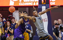 Jan 14, 2020; Morgantown, West Virginia, USA; TCU Horned Frogs center Kevin Samuel (21) and West Virginia Mountaineers forward Oscar Tshiebwe (34) fight for a rebound during the second half at WVU Coliseum. Mandatory Credit: Ben Queen-USA TODAY Sports