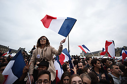 Supporters react after the official announcement of Emmanuel Macron's victory in French presidential election, at the Louvre Pyramid in Paris, France on May 7, 2017. Macron, a 39-year-old pro-business centrist, defeated Marine Le Pen, a far-right nationalist who called for France to exit the European Union, by a margin of 65.5 % to 34.1%, becoming the youngest president in France's history. Photo by Eliot Blondet/ABACAPRESS.COM