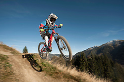 Mountain biker jumps over a bump, Saalbach-Hinterglemm, Zell am See, Salzburg, Austria