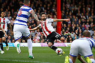Brentford defender Yoann Barbet (29) scores a goal (score 1-0) during the EFL Sky Bet Championship match between Brentford and Queens Park Rangers at Griffin Park, London, England on 22 April 2017. Photo by Andy Walter.