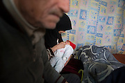 Kilis, near Syrian - Turkish border. Abu Abdo, 72 years, refugee from Aleppo, with his wife Um Abdo 33, and their baby Gais, 13 days old, he has found no work in Turkey, they live with people 5 in one tiny room, with a monthly rent of 200 dollar, the house owner asked them to leave the place. Abu says he will return to Aleppo, he has no money to stay in Turkey.