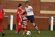 Preston StrikerJasmine Swarbrick challenged during the FA Women's Lancashire Cup Final match between Preston North End Ladies and Blackburn Rovers Women at the County Ground, Leyland, United Kingdom on 28 April 2016. Photo by Pete Burns.