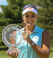 26JUL15 Lexi Thompson holds the winners trophy on the 18th green at the conclusion of Sunday's Final Round of The Meijer LPGA Classic at The Blythefield Country Club in Belmont, Michigan. (photo credit : kenneth e. dennis/kendennisphoto.com)