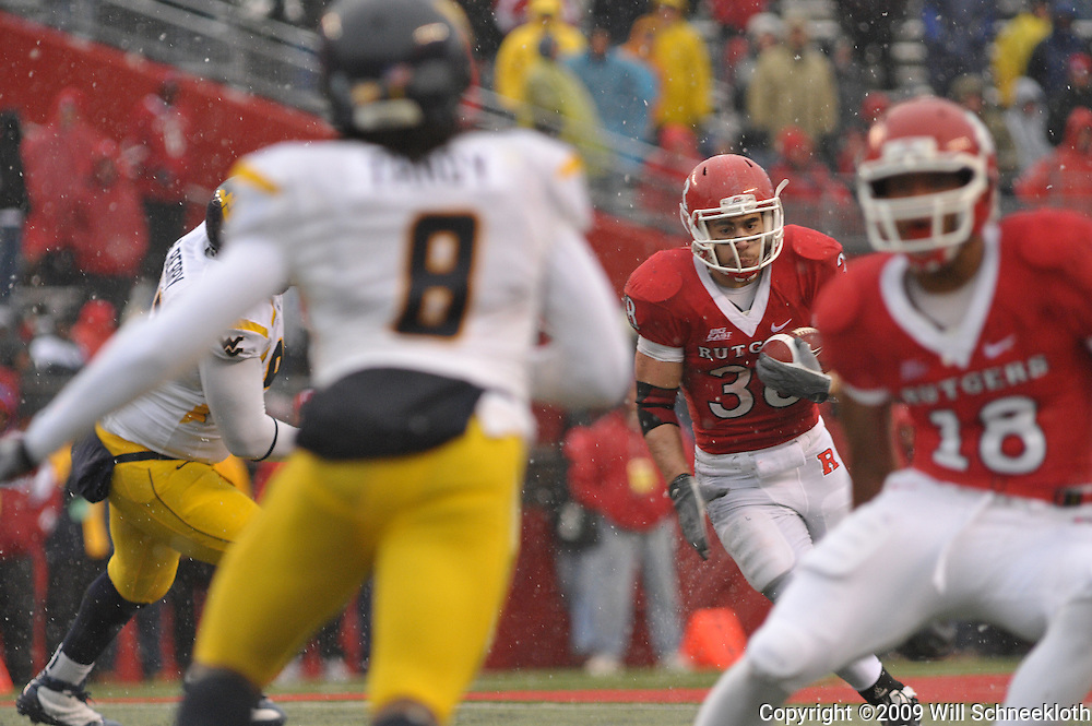 Dec 5, 2009; Piscataway, NJ, USA; Rutgers running back Joe Martinek (38) runs the ball during second half NCAA Big East college football action in West Virginia's 24-21 victory over Rutgers at Rutgers Stadium.