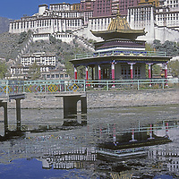 CHINA, TIBET, LHASA. The Potala, home of the now-exiled Dalai Lama, reflects in an adjacent pool in 1986. The view is now cluttered with modern Chinese structures.