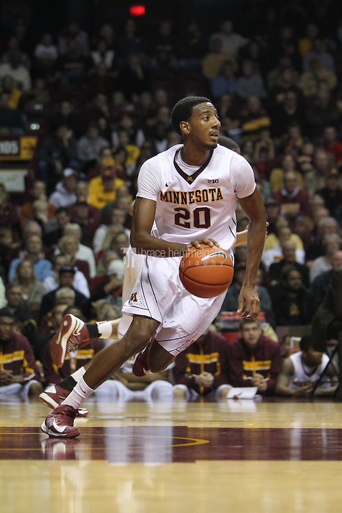Nov 18, 2012; Minneapolis, MN, USA; Minnesota Golden Gophers guard Austin Hollins (20) against the Richmond Spiders at Williams Arena. The Gophers defeated the Spiders 72-57. Mandatory Credit: Brace Hemmelgarn