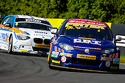 Andrew Jordan leads the chasing Robert Collard during the Dunlop MSA British Touring Car Championship at Oulton Park, Budworth, Cheshire, United Kingdom on 7th June 2015. Photo by Aaron Lupton.
