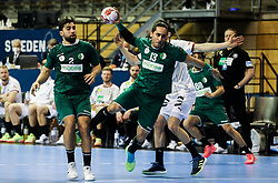 Riad Chehbour of Algeria in action during handball match between National Teams of Algeria and Germany at Day 3 of IHF Men's Tokyo Olympic  Qualification tournament, on March 14, 2021 in Max-Schmeling-Halle, Berlin, Germany. Photo by Vid Ponikvar / Sportida
