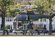Locals are caught up in downdraught as ZA939, a Westland SA-330E Puma HC1 helicopter belonging to the RAF's 230 squadron, lifts off after a five minute touch down in Ruskin Park, south London. The RAF frequently make reconnaissance flights to this Lambeth open space for crew training purposes. ..