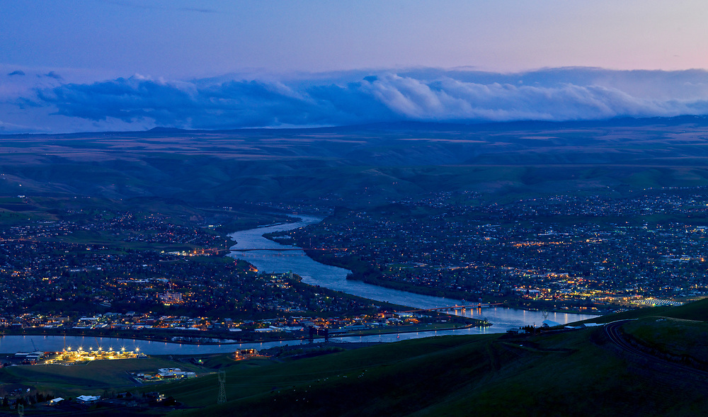 Night Scene High vista view of the Lewiston Idaho on left and Clarkston Washington on the Right separated by the Snake River with the Clearwater River converging on bottom left of frame in Springtime.  Licensing and Open Edition Prints.