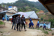 Some of the volunteers from the Devichour group visiting the local community asking them to take part in a survey, Devichou, Karyabinayak, Nepal.  ICS / Restless Development volunteers in the Dakshinkali region of Nepal. (© Andy Aitchison / ICS)