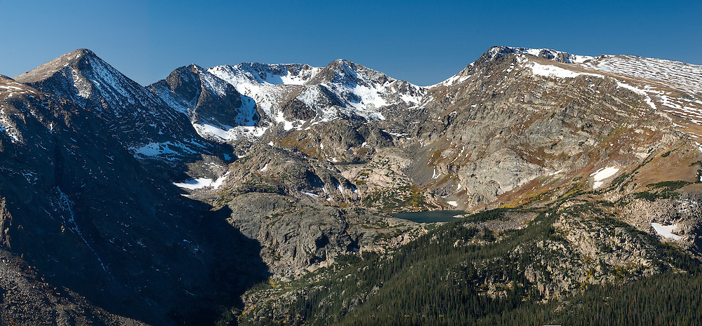 Rocky Mountain National Park, Colorado.  Bounded by Terra Tomah on one side and Mount Ida on the other, the Gorge Lakes Basin sits in the lap of several peaks.  Below that the terrain deepens even more into Forest Canyon.  On this day I took a series of shots in vertical format with an 80-200 f/2.8 lens and stitched them together in Photoshop.  This is the kind of place you could let your eyes roam over for a long time, tracing numerous routes to traverse the spectacular landscape there.  That will be another trip.