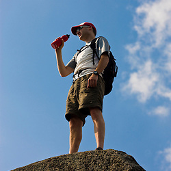 A hiker on Mount Monadnock in Monadnock State Park in Jaffrey, New Hampshire.